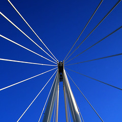 Bridge Lines 2 (Andrea Kennard) Tags: road city travel bridge blue sky cloud white abstract building tower industry beauty architecture modern river way giant spectacular concrete design construction support triangle gate arch crossing power view suspension geometry steel tube perspective arc large dramatic engineering cable structure transportation frame strong strength elegant shape tough polygon futuristic