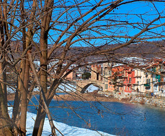A little snow... (mau_tweety) Tags: blue winter italy white snow tree tower river italia torre village branches liguria fiume neve inverno freddo rami flickrdiamond