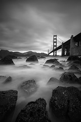 Golden Gate Bridge -  San Francisco, Calfornia (Will Shieh) Tags: ocean sf sanfrancisco california longexposure travel bridge vacation bw usa white seascape black water monochrome vertical america dark landscape golden bay coast gate san francisco rocks long exposure suspension famous smooth landmark marshall bayarea nd110