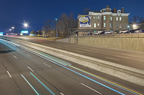 View of Interstate 55, behind Saint Agatha Roman Catholic Church, in Saint Louis, Missouri, USA - at night with Lemp Mansion