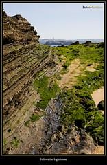 Follows the Lighthouse (Pablo Martinez Celis) Tags: lighthouse faro 50mm nikon playa f18 isla santander roca sardinero mouro