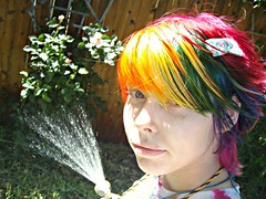 Watering the roses (Megan is me...) Tags: lighting blue light red roses portrait orange color green colors smile fashion rose yellow self hair effects photography one diy clothing crazy rainbow eyes colorful neon pretty colours russell mckay natural bright unique awesome meg violet plum megan style nuclear special clothes kind fishbowl iguana jerome colored mayhem punky striped bleached dyed napalm watering sfx rosered megface meganisme bleachednapalmorange meganyourface