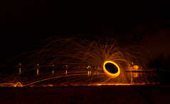 Ring of fire (pepe50) Tags: pepe50 light night lightpainting italy campogalliano cave leisure paint painting longexposure travel fun party circle fire woolsteel martian ufo alien canon canon450d emiliaromagna notte happy funny apple 450d emilia flickr imac lamp fiamme body lux fiatlux lake trail 2017 nature dark sky flare woman scintille tree water acqua blu beanch panchina