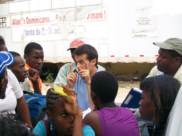 Anthony explaining to a group of Haitians why we cant give them a ride. Military check points every 5km. Exceptions for being made for haitians with no papers only if they were injured. Heart breaking.