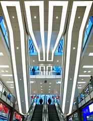 the BIG M (t0m_ka) Tags: blue cold photoshop canon mall video ece escalator center symmetry 5d blau tor retouch kalt makingof fkk available beleuchtung rolltreppe 24105 symmetrie ettlinger einkaufszentrum ettlingertor ececenter retusche flickrklubkarlsruhe istefan ba4338143106 makingofvideoavailable