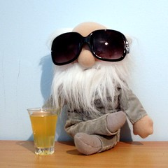 It's Darwin Day! (Kaptain Kobold) Tags: feet glass sunglasses beard grey drink lol gray darwin evolution science suit charlesdarwin friday scientist softtoy 2010 naturalselection kaptainkobold darwinday fgr yourfave futab 201years