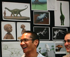 Up production designer Ricky Nierva standing in front of even more concept art from the project