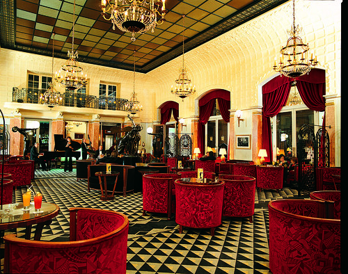 Art deco Interior Design with red seats and cool ceiling and floor ...