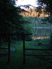 Sunset at Little River Lake (HurraH Communications) Tags: trees sunset summer lake canada reflection nature water forest lights evening boat woods brunswick canadian canoe newbrunswick archway bathurst nbphoto theacademytreealley