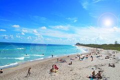 As i look to the sky (Nico Ferreira) Tags: ocean blue sea summer sky people sun color love beach clouds swim matt hotel solar sand waves shine bright florida rip shore flare tropical towels jupiter wate kornya