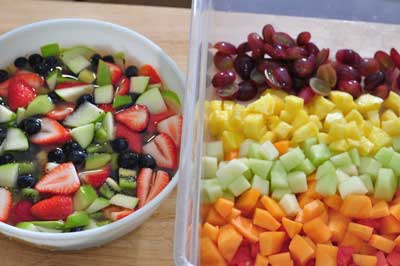 both bowls of cut fruit for fruit salad