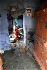 Inside her home (Henk oochappan) Tags: people woman india standing countryside village pillar madurai tamil tamilnadu ef2470mmf28lusm 2010 southindia oochappan indianphotography indianlady lifeinindia img8526 canoneos5dmarkii tamillifeculture tamilnadulifeculture madharai
