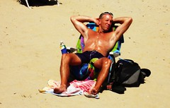 "Things that make ya go ""Hmmmmm""..... (SurFeRGiRL30) Tags: shadow shirtless summer sun man hot sexy guy beach muscles sunshine newjersey chair arms legs relaxing nj sunny oily 2009 tanning sonycybershot cuteguy glistening oceangrove beachchair"