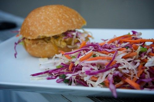 pulled pork sandwich with a side of slaw