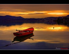 Boat in Lake...::[1000+ views Thank you] (ktania) Tags: sunset red mountain lake art water canon landscape boat spring explore frontpage kastoria buoyant 400d saariysqualitypictures sailsevenseas taniakoleska peregrino27newvision
