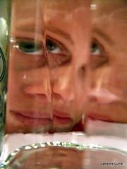 23/52 Catherine through the liquid glass. (LPM) Tags: portrait distortion selfportrait eye glass bottle pentax blueeyes australia victoria refraction gin distort plymouthgin mothersruin 52weeks genieinabottle throughabottle selfportraitfridaychallenge