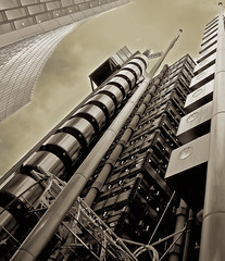 lloyds of london (Aristotle Liu) Tags: world city bw building london tower industry yellow architecture modern spread high lift risk angle market flag perspective powershot highrise british tradition scape financial insurance futuristic lloyds liverpoolstreet incorporated s90 corporations banker londoner londonist 1871 competitors reinsurance unexplored pinoykodakero vftw