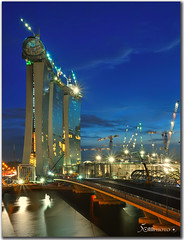 Double Helix bridge - Marina Bay Sands Singapore (fiftymm99) Tags: bridge reflection tourism ir construction nikon singapore casino bluehour singaporeriver d300 integratedresort marinasouth helixbridge marinabaysands singaporetourismboard nikond300 doublehelixbridge marinabaysand micartttt fiftymm99 thehelixbridge thedoublehelixbridge michaelchee micarttttworldphotograhpyawards