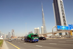 TRUCKING IN DUBAI (Claude  BARUTEL) Tags: world building dubai united transport emirates khalifa arab sharjah trucking burj tallest the in