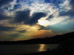 quando un sogno diventa cielo (lucia bianchi) Tags: light sunset sea sky sun reflection nature clouds tramonto nuvole mare shadows natura ombre cielo sole luce riflesso the4elements flickrawards grandemaregroup platinumpeaceaward travelsofhomerodyssey allegrisinasceosidiventa kernoart peregrino27newvision