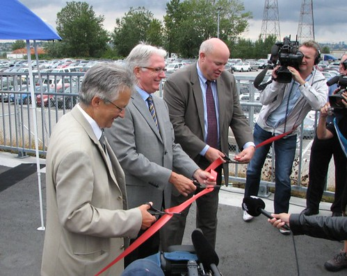 Former TransLink CEO and new NYCTransit President Thomas Prendergast (far right) cuts the ribbon on a new bike bridge in Vancouver)