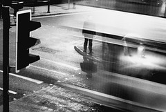 I stand still, while time goes by (HAMED MASOUMI) Tags: street uk light shadow man motion bus film canon manchester trafficlight stand persian alone time iso400 iranian a1 analogue crossroad hamed   mycrossroad masoumi  developedbymyself  legacypro