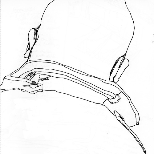 Bald man with glasses and ear buds