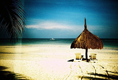 one sunny afternoon at the beach (darkcanopy) Tags: travel blue sea vacation color film tourism beach analog lomo lca xpro lomography crossprocessed colours afternoon tour phil kodak lka crossprocess philippines lofi sunny slide lomolca lightleak photograph shade 1984 heat bohol analogue ph russian cyrillic vignetting vignette  analogphotography lomograph bluegreen panglao 84 lowfi compactcamera  russiancamera filmphotography elitechromeextracolor xprod omo ebx lomolove analoguephotography cyrilliclettering elitechome ka omoka russiancam