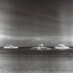boats and infrared (darkcanopy) Tags: travel sea blackandwhite bw mamiya film tourism beach analog ir boats mono blackwhite tour noiretblanc philippines lightleak infrared bohol maco 28 analogue ph expired  mamiyac3 analogphotography f28 panglao hoya twinlensreflex c3  80mm normallens r72 filmphotography hoyar72 macophot mamiyasekor macoir820c 80mmf28 mamiyatlr 80mm28 macophotir820c ir820c mamiyac380mmf28