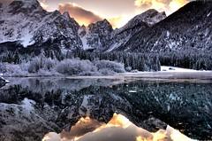 Lago di Fusine (soundwave) Tags: sunset italy snow reflection water landscape lago mirror reflex tramonto neve fvg friuli riflesso fusine tarvisio platinumheartaward