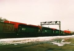 Two Burlington Northern freight trains meet in La Grange Illinois. January 1987.