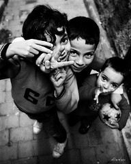 V (ale neri) Tags: street travel portrait people blackandwhite bw blackwhite eyes child hand morocco fez maroc marocco marruecos marokko moroccan fes reportage fs childreen aleneri alessandroneri