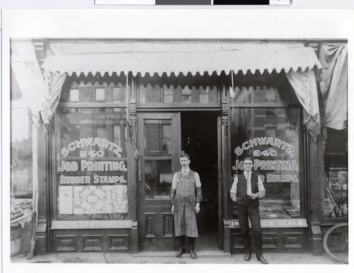 Proprietor and printer in front of Schwartz Print Shop in Minneapolis