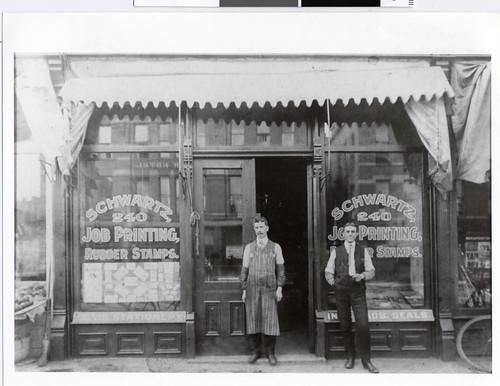 Proprietor and printer in front of Schwartz Print Shop in Minneapolis