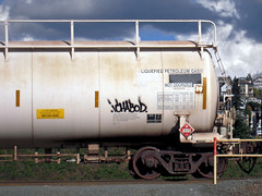 Ichabod (everkamp) Tags: seattle railroad sky clouds graffiti washington trains ich freight tanker ichabod rollingstock railart tankcars benching