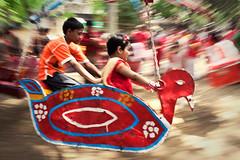 Juvenile Voyage (Iftekhar_Himel) Tags: red motion festival kids children movement child newyear celebration pan merrygoround bangladesh bangla bengali boishakh charukola