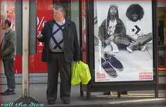 `1079 (roll the dice) Tags: life uk people urban man black london art classic fashion shopping hair bag advertising traffic natural candid afro streetphotography stranger busstop converse unknown wisdom unaware marksspencer kingsroad kensingtonchelsea sw3 poretrait
