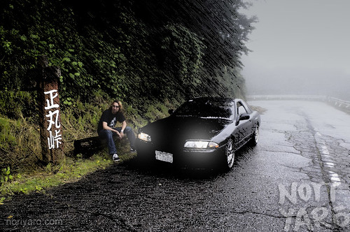 A cool car with a cool guy. Cool picture.
