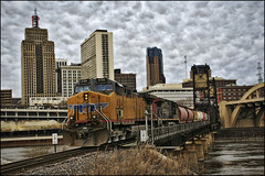 saint paul downtown freight (Dan Anderson.) Tags: city railroad bridge urban fall water minnesota architecture clouds train buildings river mississippi downtown gloomy grunge tracks stpaul railway overcast transportation unionpacific twincities mn freight tressel robertstreetbridge verticallift