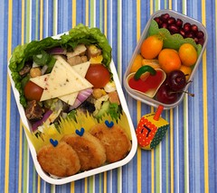 potato latkes bento [explored] (gamene) Tags: cheese salad cherries chanukah hanukah pomegranate potato bento kumquats latkes dreidel