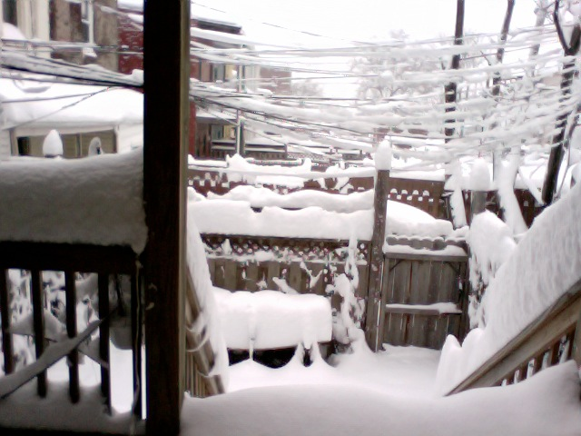very snowcovered porch/alley