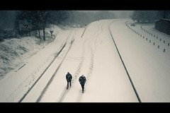Walking was the only choice... (Fabrice Drevon) Tags: road snow man france cold lines sign walking 50mm nikon track candid perspective exit f18 curve cinematic footprint speedway mougins d700 fabricedrevon