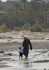 Father and son crossing the wadi in Sinaw, Oman (Eric Lafforgue) Tags: river eau riviere arabia fatherandson oman wadi sina omn  sultanate arabie  7418 traveldestination sultanat arabianpeninsula sinaw om  omo umman pereetfils omaan     omna omanas umn penisulearabique