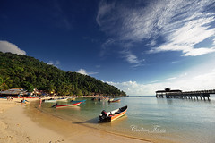 need to swim! (cteteris) Tags: ocean travel sea sky holiday beach clouds island pier boat sand hill wideangle jungle shore malaysia coralbeach perhentiankecil nikond700 1424mm28 gettyvacation2010 gettymalaysiafeb gettyimagessingaporeq2