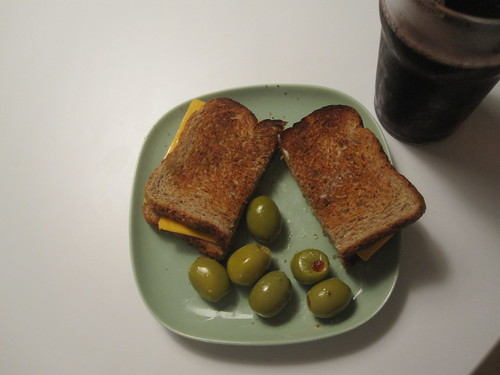 Cheese sandwich, olives, grape juice