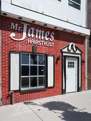 Mister James is a storefront stylist. (Tim Kiser) Tags: 2016 20160829 august august2016 capitaldistrict capitalregion highway5 img8199 james misterjames mohawkvalley mrjames mrjameshairstylist newyork newyork5 newyorkhighway5 newyorkroute5 newyorkstate newyorkstateroute5 route5 schenectady schenectadycounty schenectadycountynewyork schenectadynewyork stateroute5 statestreet abandonedbuilding abandonedbusiness beautyparlor beautyparlorstorefront beautysalon beautysalonstorefront beautyshop beautyshopstorefront brickstorefront bricks business businessfailure closedforbusiness door downtown downtownschenectady downtownstorefront easternnewyork easternnewyorkstate failedbusiness fakeshutters fakewindowshutters flamboyantj formerbusiness hairparlor hairparlorstorefront hairsalon hairsalonstorefront hairstylist lamppostshadow paved pavement pediment phonyshutters phonywindowshutters pilasters redbricks shadowsofhangingflowerbaskets shutters sidewalk stoneshutters storefront upstatenewyork window windowshutters unitedstates