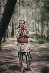 Forest portrait. Himachal Pradesh, India (Marji Lang Photography) Tags: 50mm 50mm12 canon5dmarkii himachal himachalpradesh himachalwoman himachali himalaya himalayan himalayanforest india indian indiansubcontinent solan travelphotography bokeh countryside cuttingwood depthoffield documantaryportrait documentary documentaryportrait documenting ethnic forest forestpath foresttrail fullbody localpeople machete machette mood moodyforest nature northernindia oneperson onewoman path people perspective photography pines portrait realworld region subject travel trees typical vertical villager woman woods