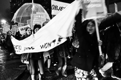 women dancing holding banner