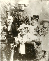 Barker family circa 1903 (earthsound) Tags: old family portrait blackandwhite dog kids children beard parents married hats scanned familydog barker oldphotograph household familyportrait beardedman 1900s 1903 oldfamilyphoto halfsister poorlycropped early1900s barkerfamily circa1903 oldfamilyportrait gracebarker minniebarker claudiebarker williamcarybarker franceswadebarker janiebarker annieloualmabarker