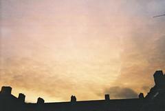 (Hannah Alicia) Tags: sunset sky london clouds sunrise 35mm rooftops filmcamera grainy chimneys cirrus altocumulus